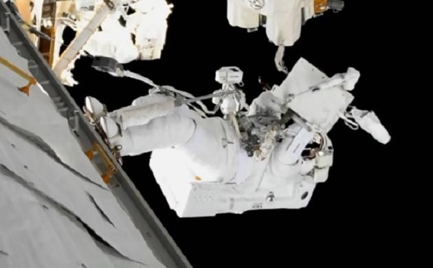 NASA astronauts grease robot arm's new hand (Source: NASA)