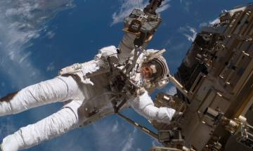 Spacewalking astronaut successfully replaces blurry camera outside International Space Station, copes with frayed tether, bad jetpack