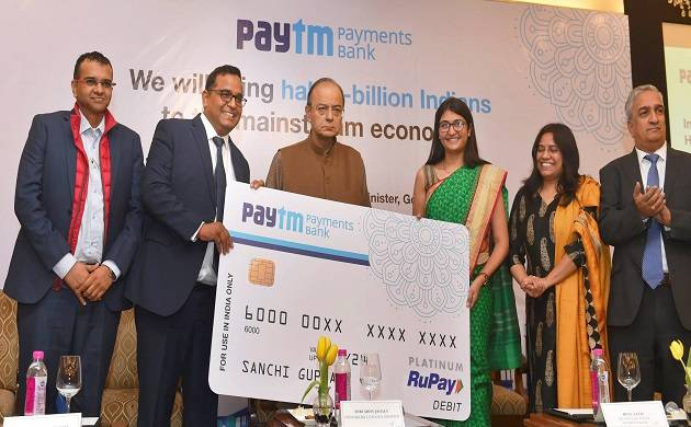 Union Finance Minister Arun Jaitley with Paytm founder and CEO Vijay Shankar Sharma and MD and CEO Paytm bank, Renu Satti at the launch of Paytm Payments Bank in New Delhi on Tuesday. (PTI photo by Shahbaz Khan)