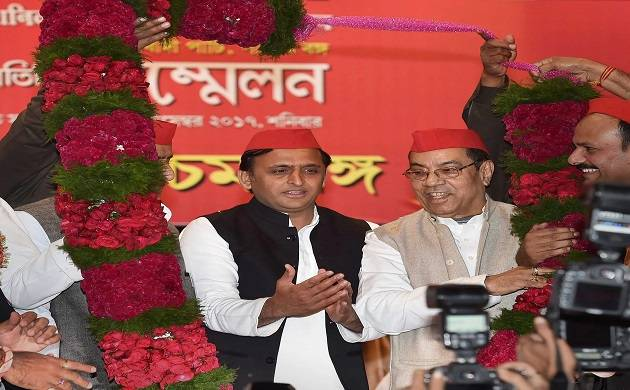 Former chief minister of UP Akhilesh Yadav being garlanded by his supporters during a function in Kolkata on Saturday. (PTI Photo)