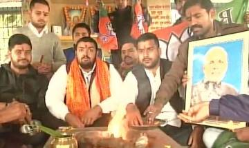 Gujarat, Himachal election results: BJP, Congress supporters perform 'havan' as counting of votes underway
