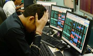 Sensex retreats from record high, falls 244 points, Gold begins 2018 on flat note