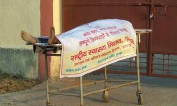 Watch video   Jharkhand hospital wraps dead tribal youth with govt adv poster