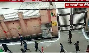 Watch   Video from UP's Kasganj shows young men armed with guns, swords on street