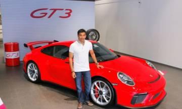 Formula One racer Narain Karthikeyan takes keys of his new Porsche 911 GT3