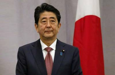 Defiant Shinzo Abe hits back over scandal as support plunges