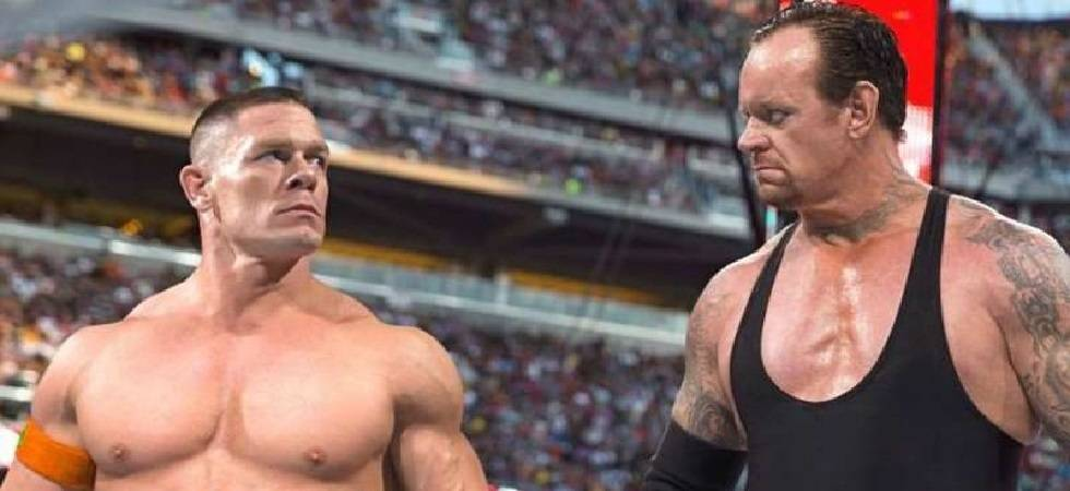 Image result for WWE The Undertaker and John Cena