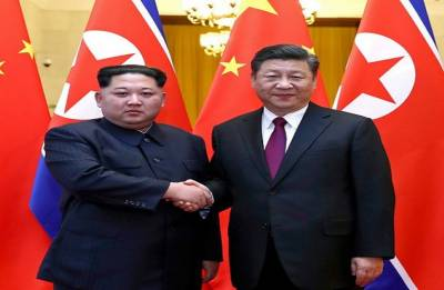 Kim Jong Un holds talks with Chinese President Xi Jinping during 'unofficial visit' to Beijing