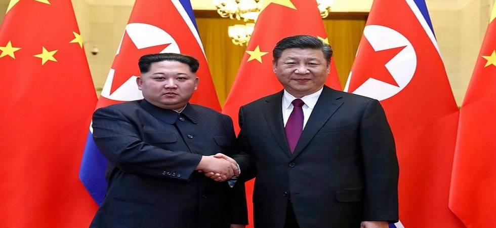 Kim Jong Un and Chinese President Xi Jinping - File Photo