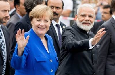 PM Narendra Modi holds talks with German Chancellor Angela Merkel; discusses bilateral, global issues