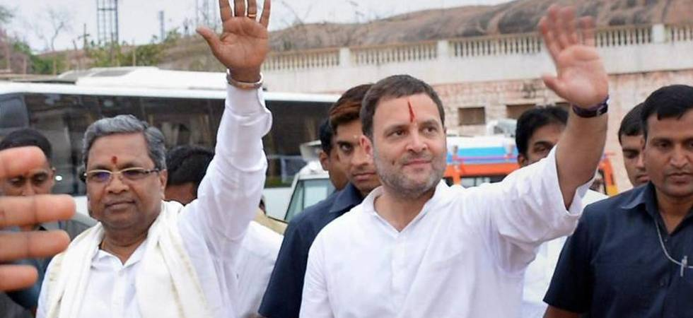 Karnataka CM  Siddaramaiah and Congress president Rahul Gandhi waving at crowd (PTI Photo)