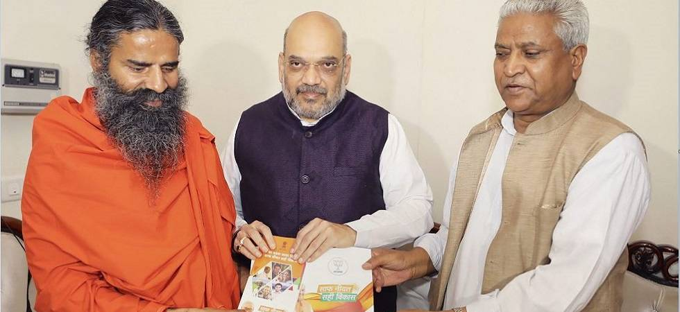 Amit Shah meets Ramdev to inform about NDA government's achievements (Photo Source: PTI)