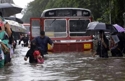 Monsoon hits Mumbai, flights delayed, trains running late due to heavy rains