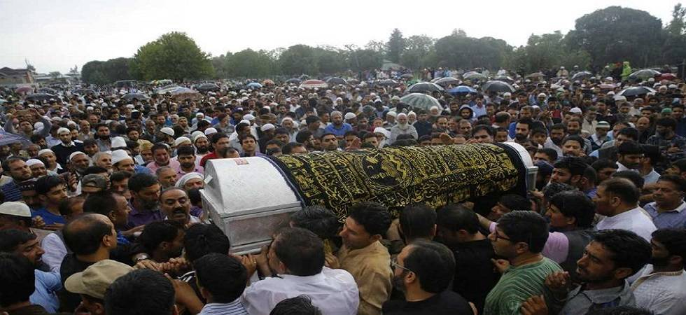 Journalist Shujaat Bukhari was laid to rest in his ancestral village with thousands of mourners attending the burial braving heavy rain