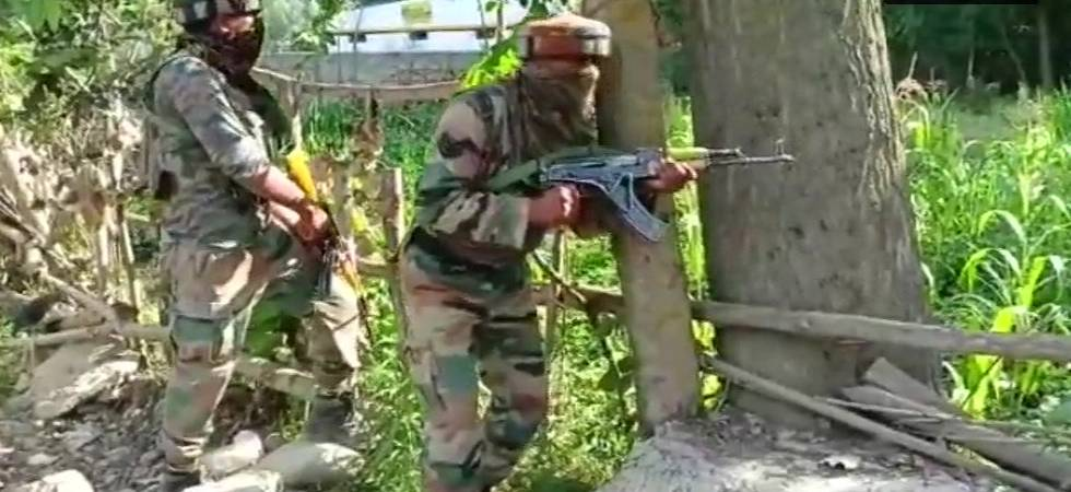 Two Security force personnel taking positions during Kulgam encounter (Deferred visuals/ ANI)