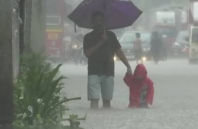 Mumbai Rains: Heavy downpour inundates city; traffic hit, trains running late, schools closed