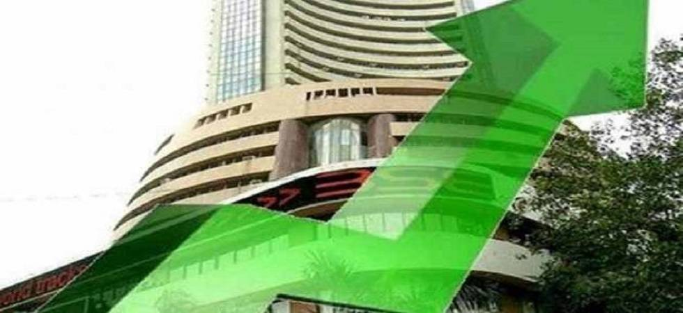 Sensex hits fresh record high on firm global cues