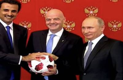 Russian President Vladimir Putin passes torch to Qatar for World Cup 2022