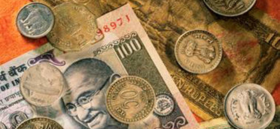 Rupee slips 12 paise to 68.74 against US dollar