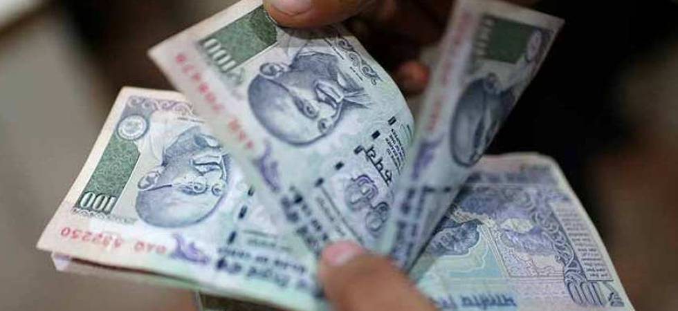 Rupee declines 5 paise, hits 2-week low against US dollar