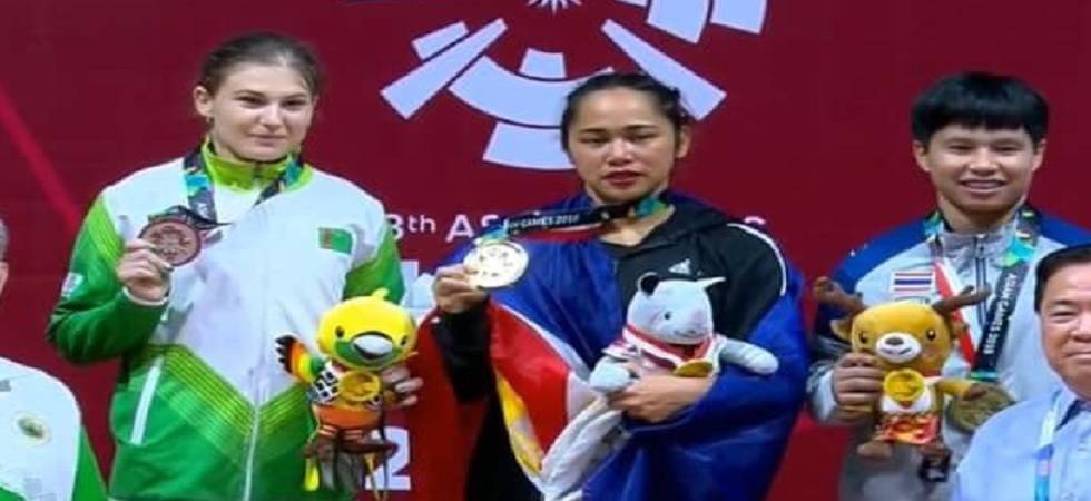 Triumphant weightlifter Hidilyn Diaz has her sights set firmly on Olympic gold, inspired by her new Chinese coach (PHOTO: Twitter)