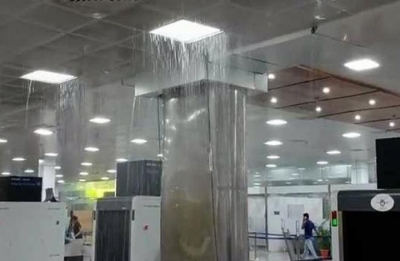 Rain water floods passenger lounge of Guwahati airport
