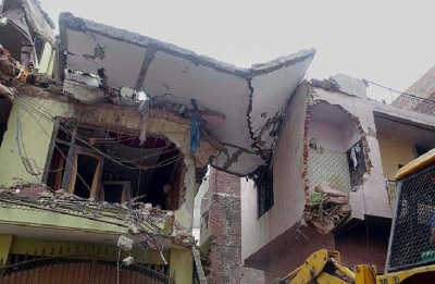 Woman killed, husband injured as house collapses in Greater Noida