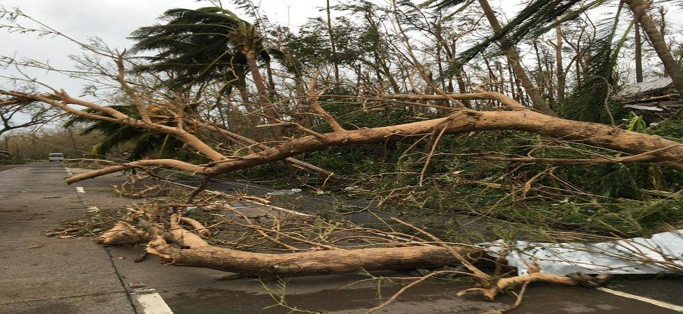 Powerful Typhoon Mangkhut lashes Philippines, killing at least three (Photo- Twitter/@CAREphl)