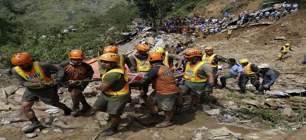 Philippines: Landslide kills 18, buries houses in Cebu (Photo- Twitter)