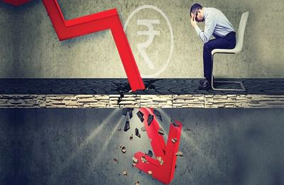 Rupee hits a new low of 74.27 against dollar