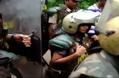 Sabarimala: Two women begin climbing hill shrine amid strong protests