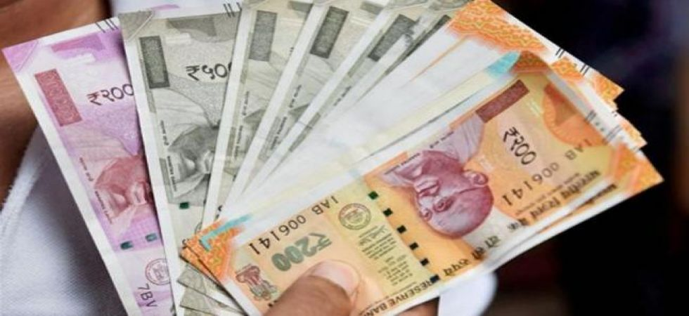 Re may trade at 69.79 in H2 if RBI mops up $30 bn from NRIs (Representational image: PTI)