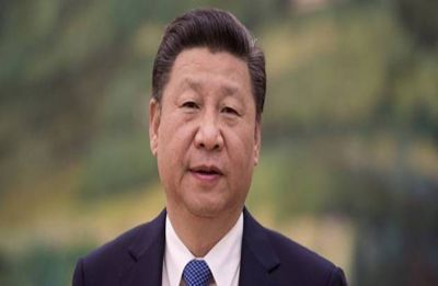 President Xi Jinping pledges to 'step up' opening China's markets as criticism grows