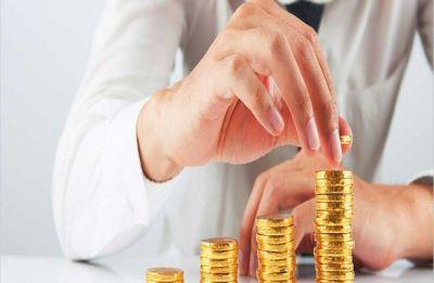 Gold futures succumb to profit-booking, global cues