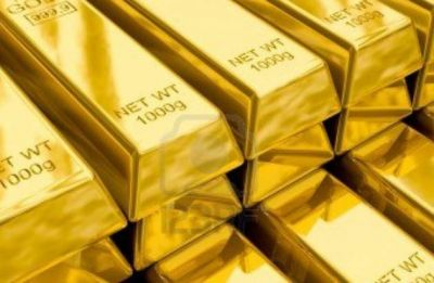 Gold dips on low demand, global cues