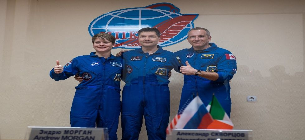 The three-man crew met their relatives and appeared briefly before reporters on Monday morning (Photo: Twitter@Space_Station)