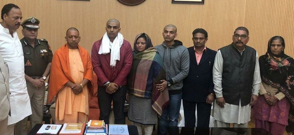 Uttar Pradesh director general of police (DGP) OP Singh was also present during the meeting of Yogi Adityanath with family members. (ANI Photo)