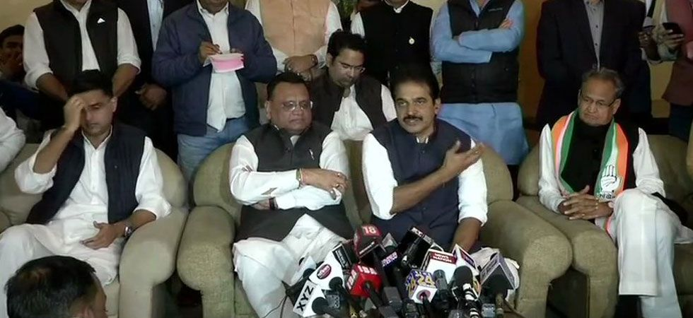 Rajasthan Congress chief Sachin Pilot (Extreme left), Ashok Gehlot (Extreme Right) during a press conference in Jaipur today. (Photo/ANI)