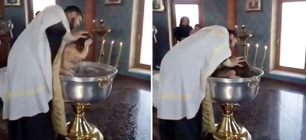 Priest forcefully baptises 2 year-old girl (Photo: Twitter)