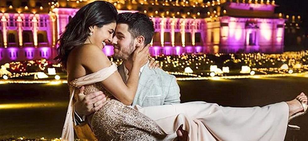 Priyanka looks absolutely gorgeous in a pastel-coloured gown while Nick looks suave in a checkered suit./ Image: Instagram