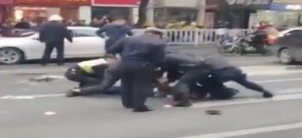 A video footage posted online shows police personnel are wrestling with the attacker on a street as a crowd gathers around him.