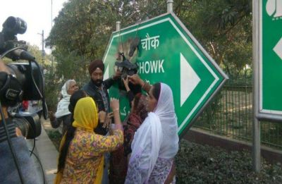Rajiv Chowk signboard defaced with black ink in Connaught Place