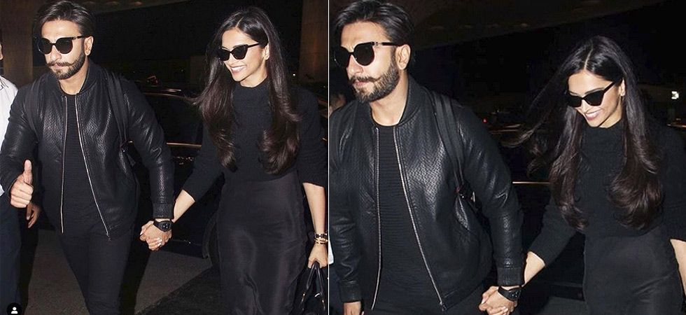 Twinning in black, the couple was spotted walking hand in hand at the Mumbai airport.