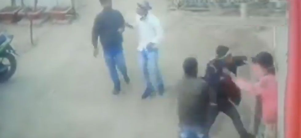 A group of men assaulting the woman. (Screen grab of CCTV footage/ANI)