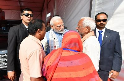 PM Modi meets parents of Doordarshan's cameraman Achyutanand Sahu, who was killed by Maoists