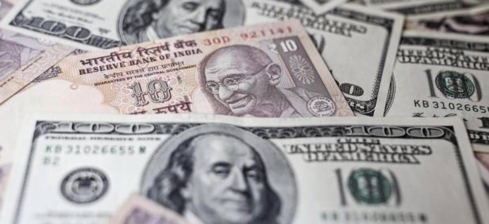 Rupee firms up by 26 paise against US dollar on easing crude prices (file photo)