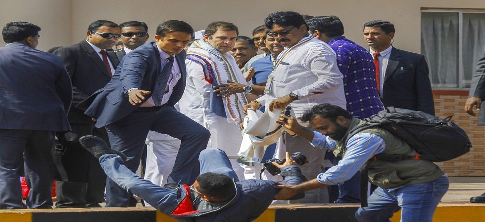 Rahul Gandhi helping photographer who tripped and fell at Bhubaneswar airport. (Photo: PTI)