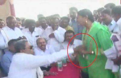 Watch: Former Karnataka CM Siddaramaiah misbehaves with woman in Mysuru, video goes viral