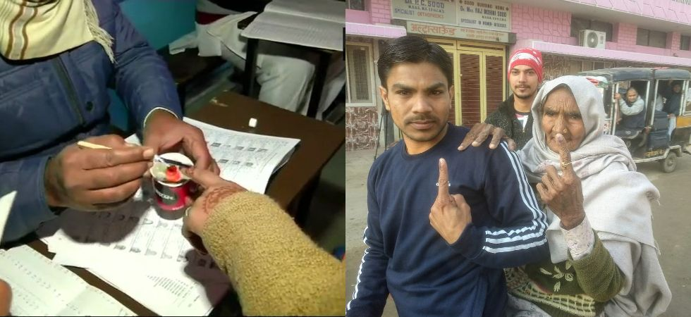 Braving cold weather conditions, people could be seen queuing up at various polling booths to cast their vote. (Photos tweeted by ANI)