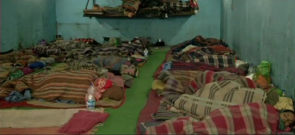 People take refuge at night shelters as cold wave intensifies in the national capital. These are visuals from a night shelter in Munirka. (Photo: ANI)